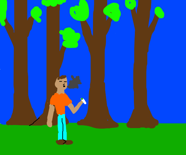 Guy smokes weed in a forest