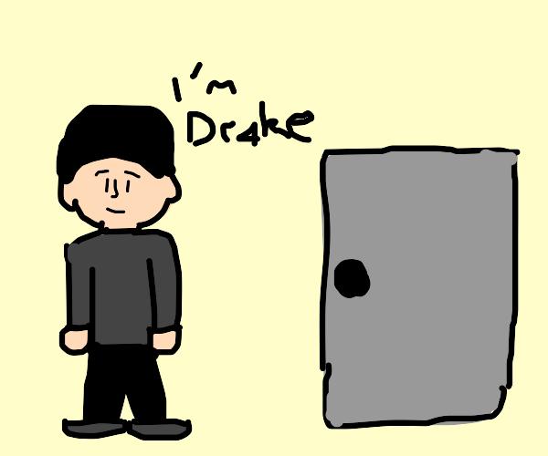 Drake standing by door