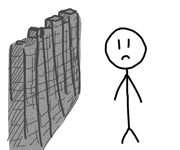 Sad person with a wall