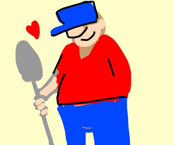 Bearded guy with big hat loves shovel
