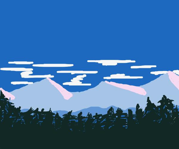 snowy mountains above dark woods