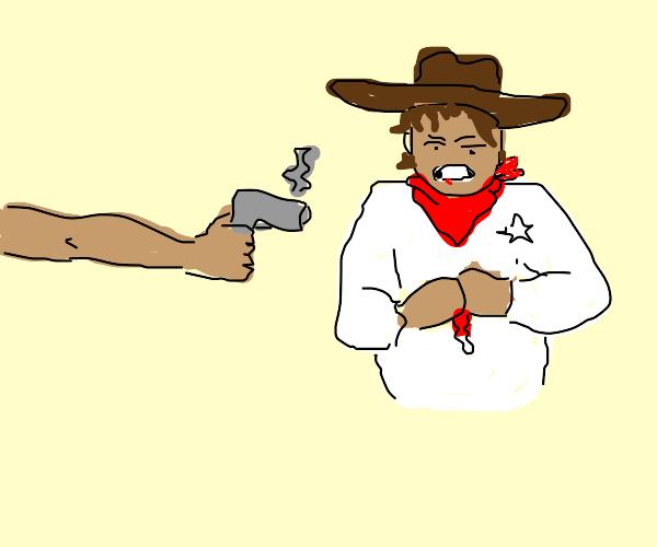 A cowboy got shot with a gun