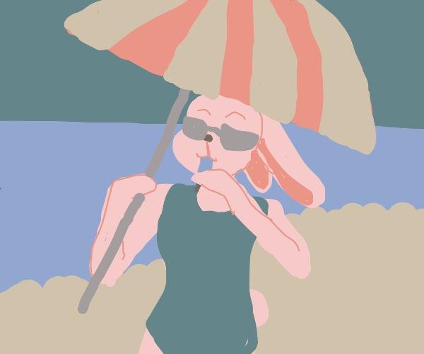 anthropomorphic bunny on a beach