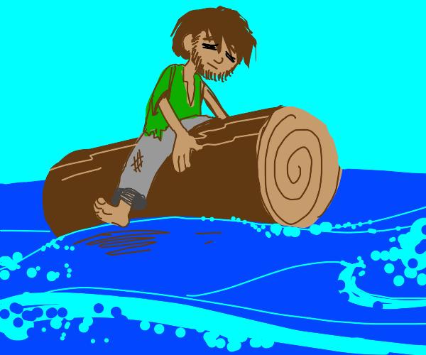 man sitting on a log in the ocean