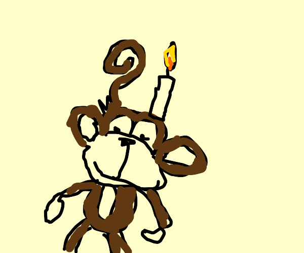 monkey with candle on head grins menacingly
