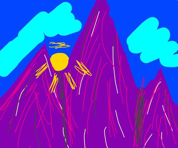 The sun rising on purple mountains