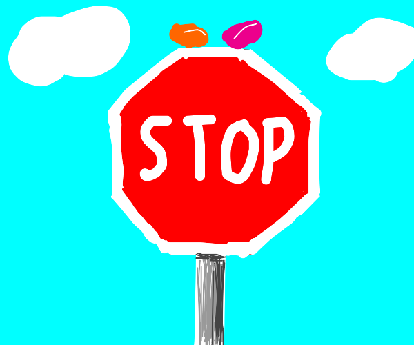 Stop sign and two jelly beans