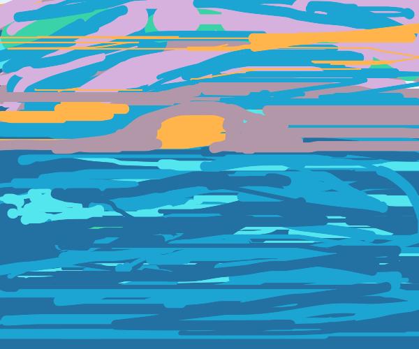Sun setting beyond the ocean