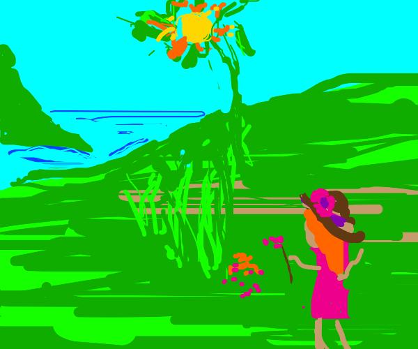 girl picking flowers in a field