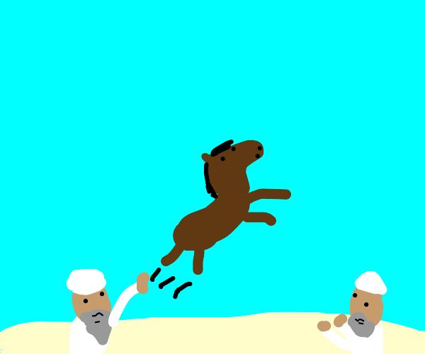 2 arabs ride horse threw the desert
