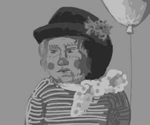 Upset boy has clown nose and balloon