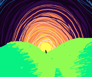 Man watches sunset in a valley