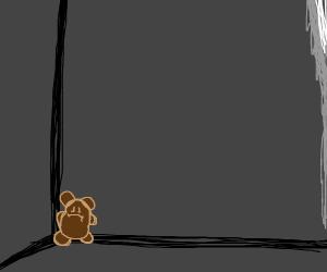 teddy bear in an empty room
