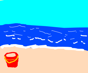 a red bucket filled with sand at the beach