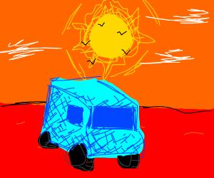 a blue van in open land