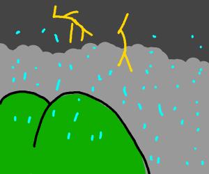 buttcheek-shaped hills on a rainy day