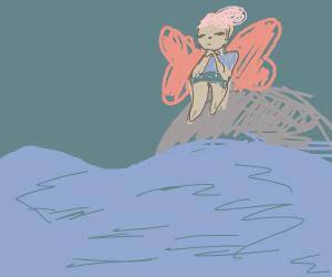 Fairy on a rock in the ocean