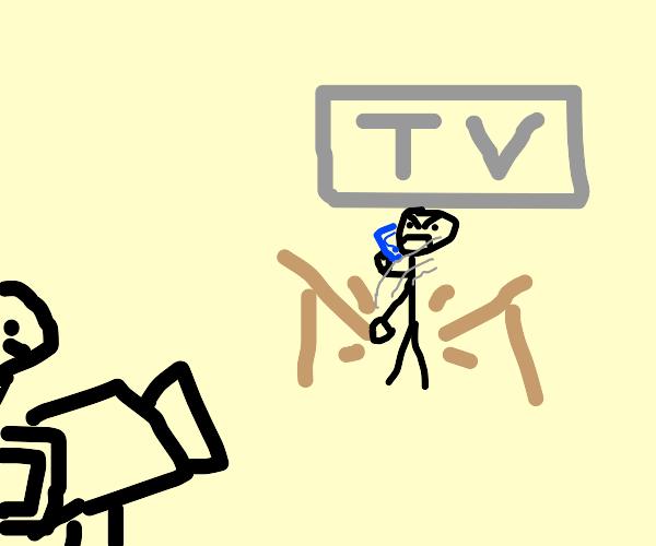 tv presenter breaking the desk in a phone cal