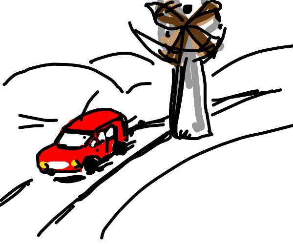 A red car and a windmill