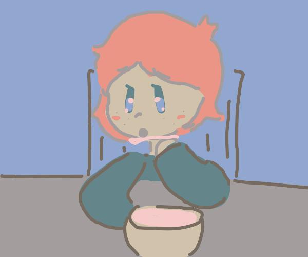 Red head eats porridge