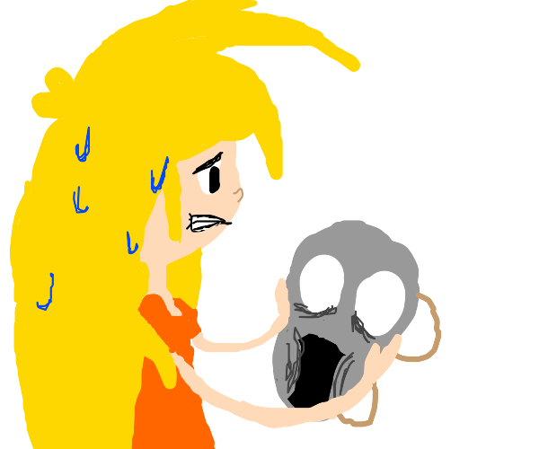 Spiky haired blonde holding a scary grey mask