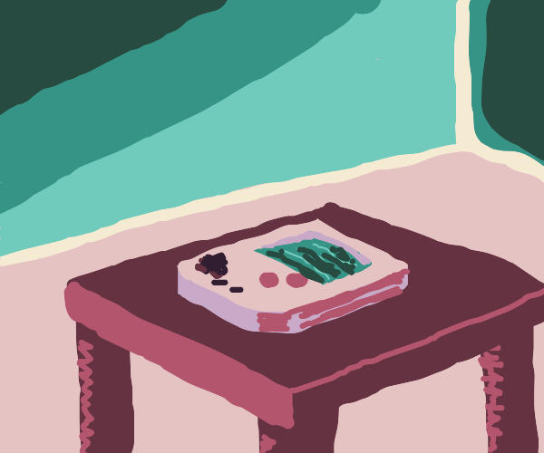 A gameboy on a table