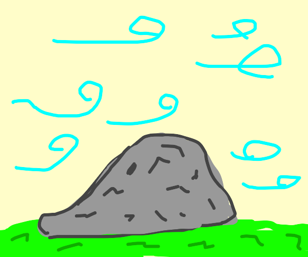 rock in grass, with wind blowing on it