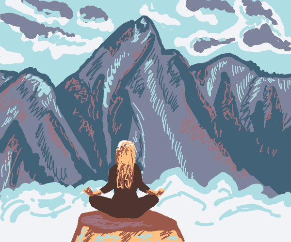 Meditating in front of a view of mountains