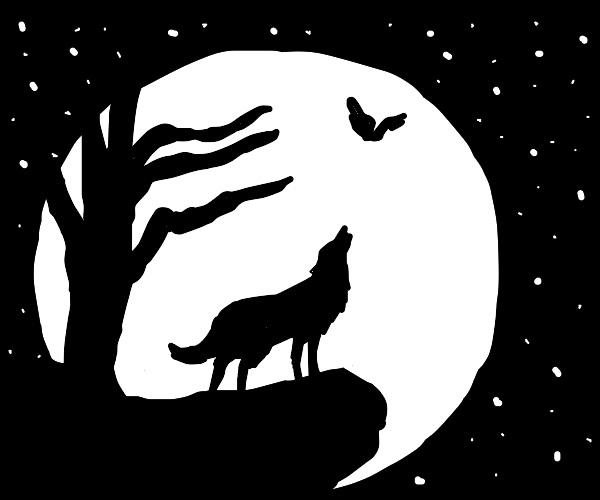 Wolf on a cliff howling at the moon