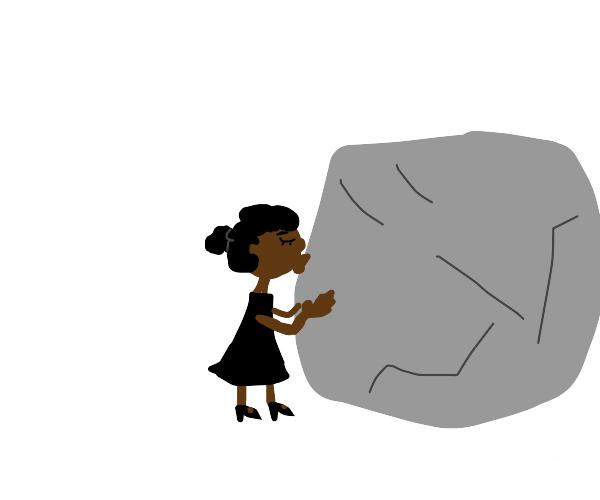 Girl kisses a rock