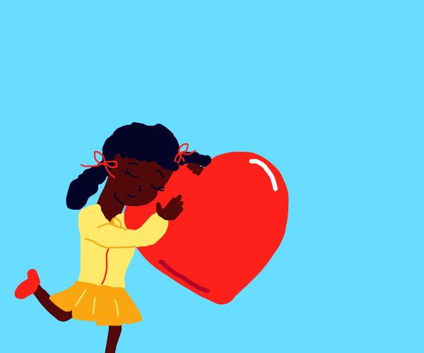 Girl hugs a heart