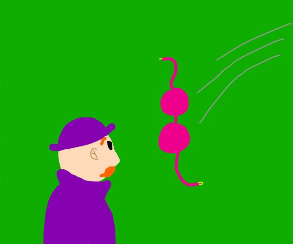 man in purple watches someone strip