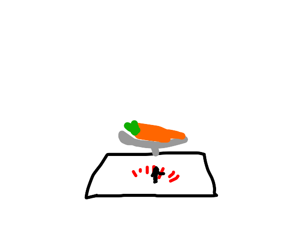 Carrot being weighed