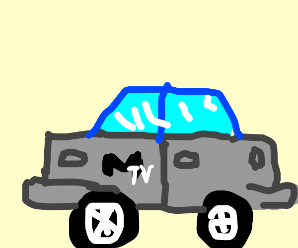a grey car with the MTV logo on the side