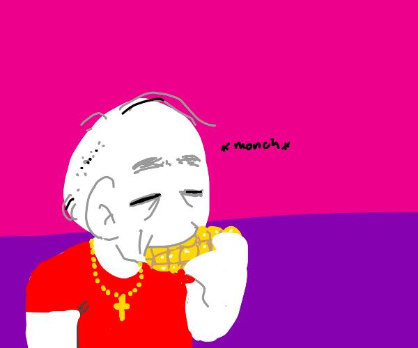 Old Christian man eating corn on the cob