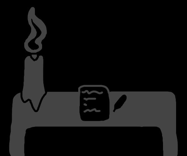 desk with a candle and paper