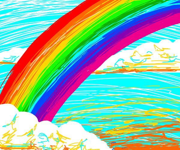 Rainbow on light blue sky, white clouds