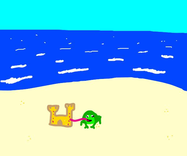 Frog licking sand castle