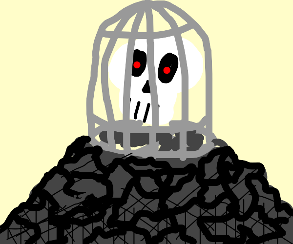 skull in a cage on a pile of gravel