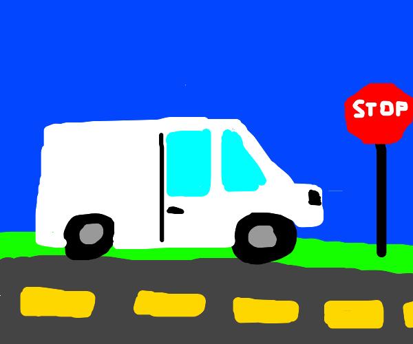 White van at a stop sign