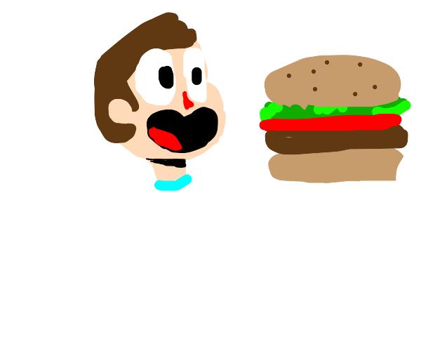 Man eats unusually large burger