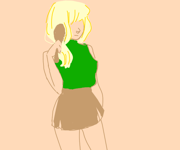 Blond person wearing green brushes their hair