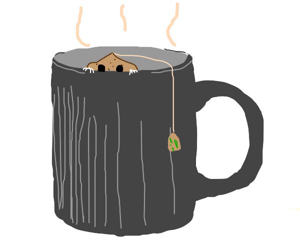 Tea bag hides in a mug of coffee