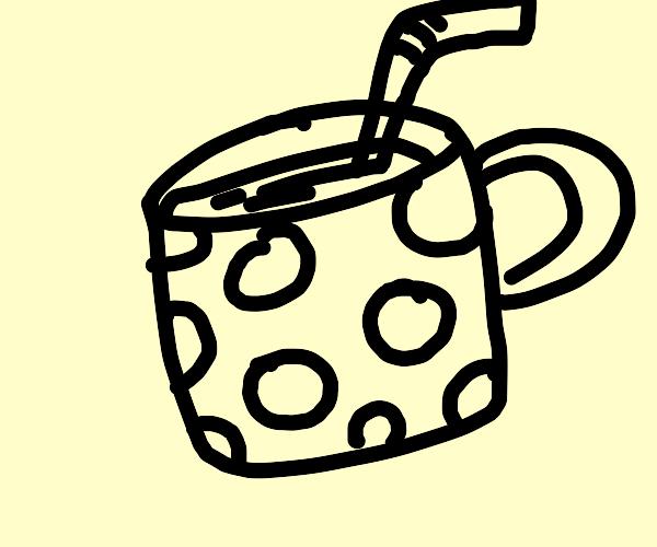 Polka dot mug with juice in it