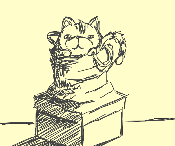 kitten in a bag sits atop a box