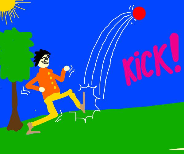 guy accidentally kicks red ball into the sky