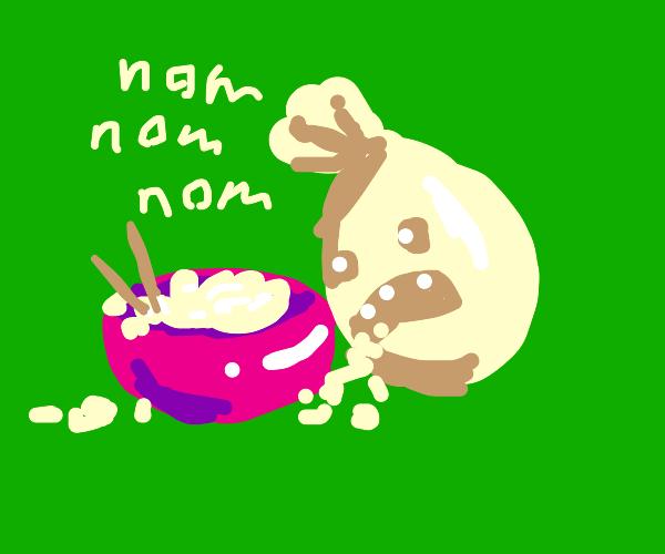 Sandbag messily eats bowl of rice
