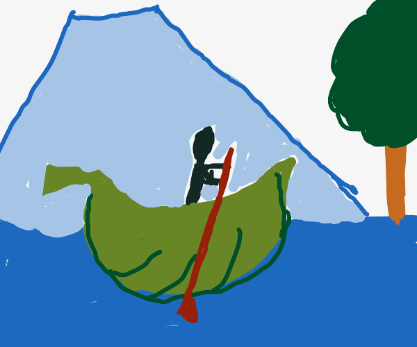 A leaf-shaped boat near mountains and trees
