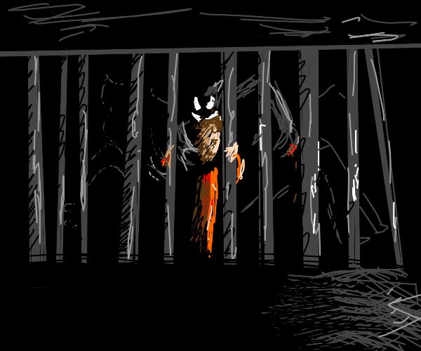 Creature grabbing a prisoner