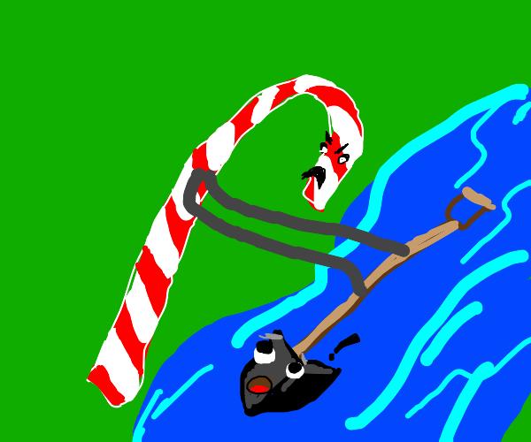 Candy Cane shoves a shovel in river